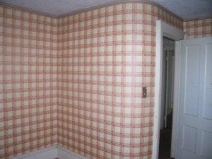 The '70's orange and brown plaid porn-set wallpaper.